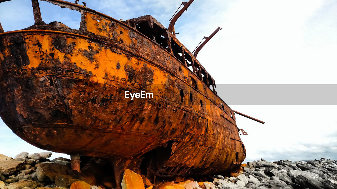 sky, mode of transportation, transportation, abandoned, rusty, metal, day, nature, damaged, deterioration, decline, run-down, obsolete, no people, outdoors, nautical vessel, ship, old, cloud - sky, shipwreck, wheel