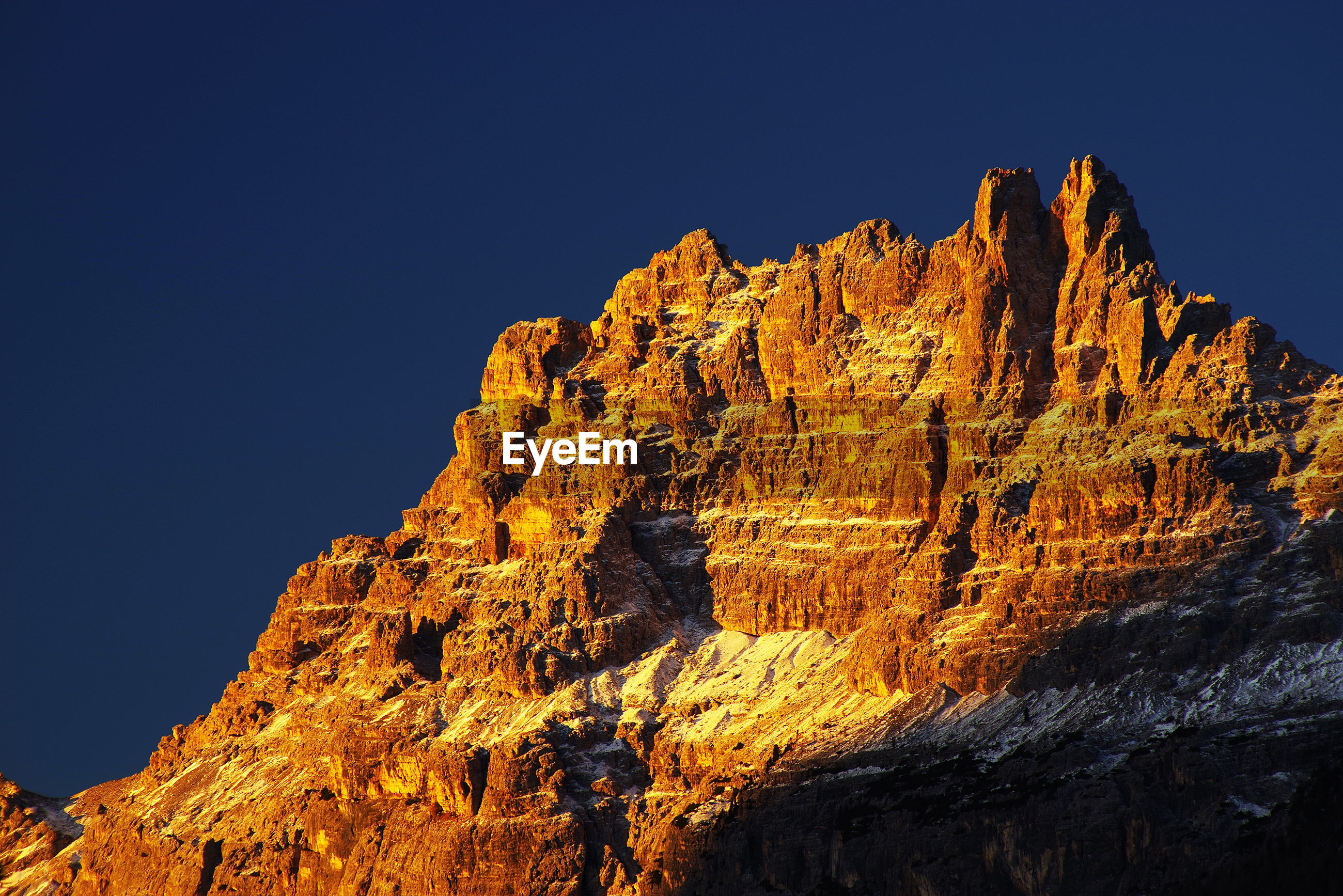 LOW ANGLE VIEW OF ROCKY MOUNTAINS AGAINST CLEAR BLUE SKY