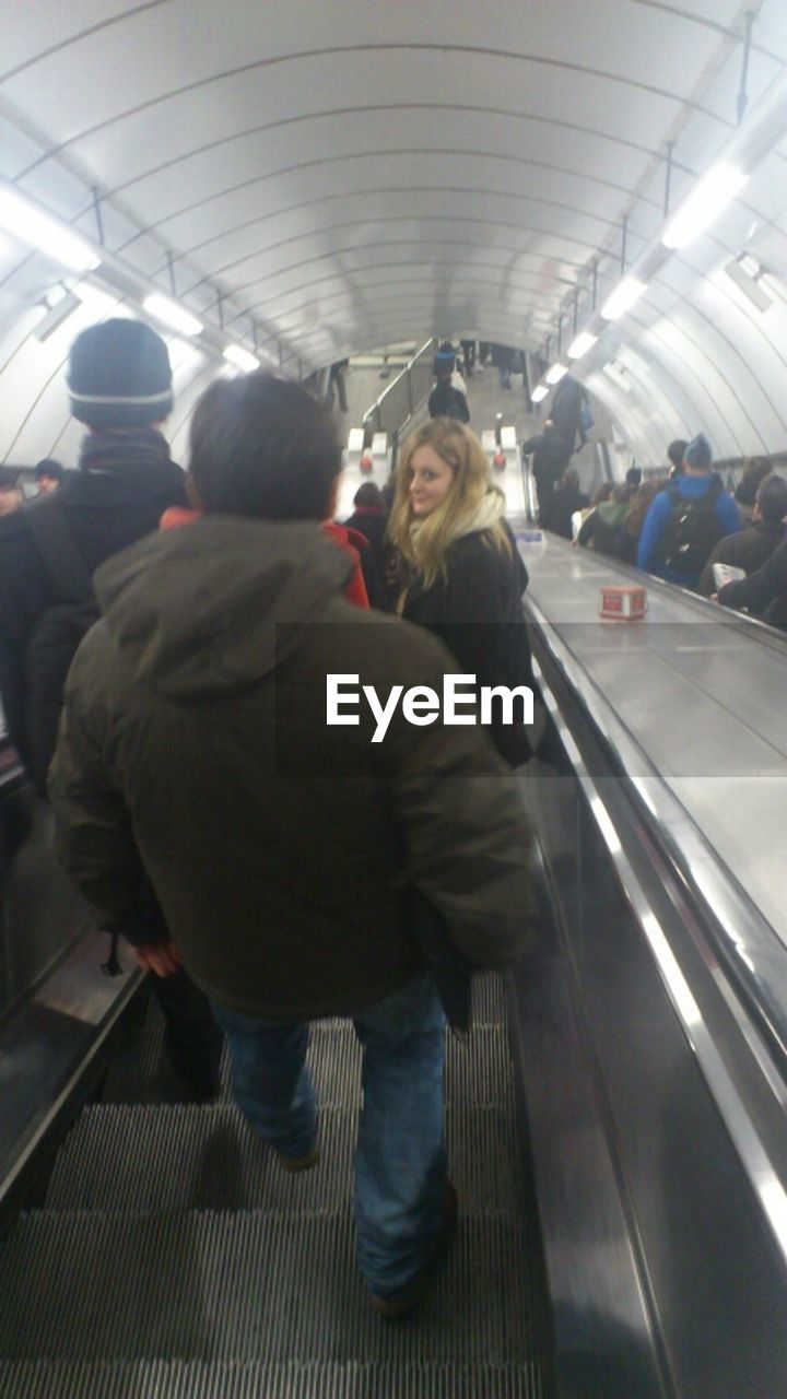 real people, indoors, lifestyles, full length, men, women, transportation, public transportation, leisure activity, togetherness, subway station, large group of people, warm clothing, day, adult, people