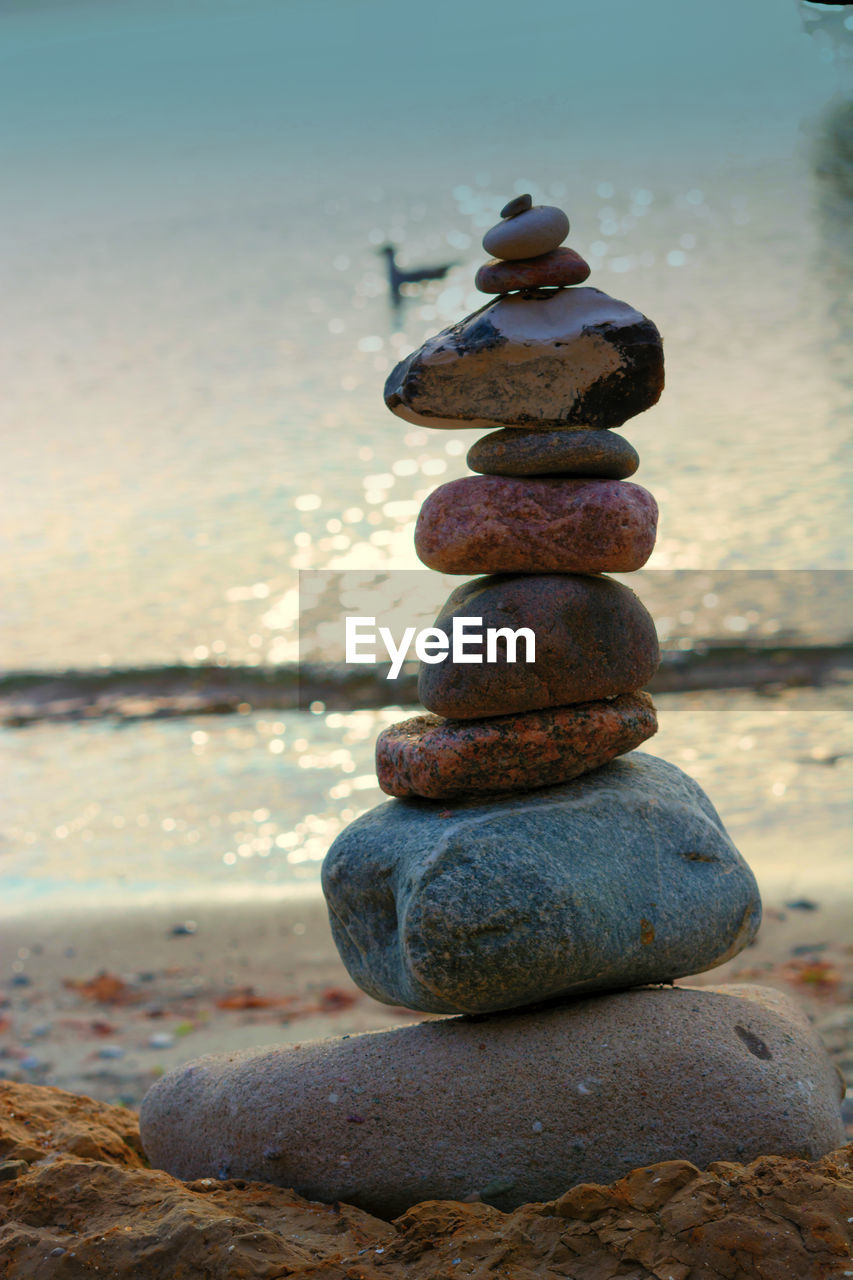 stack, solid, stone - object, rock, zen-like, balance, water, pebble, rock - object, beach, stone, land, sea, nature, sky, focus on foreground, tranquility, no people, stability, outdoors, horizon over water