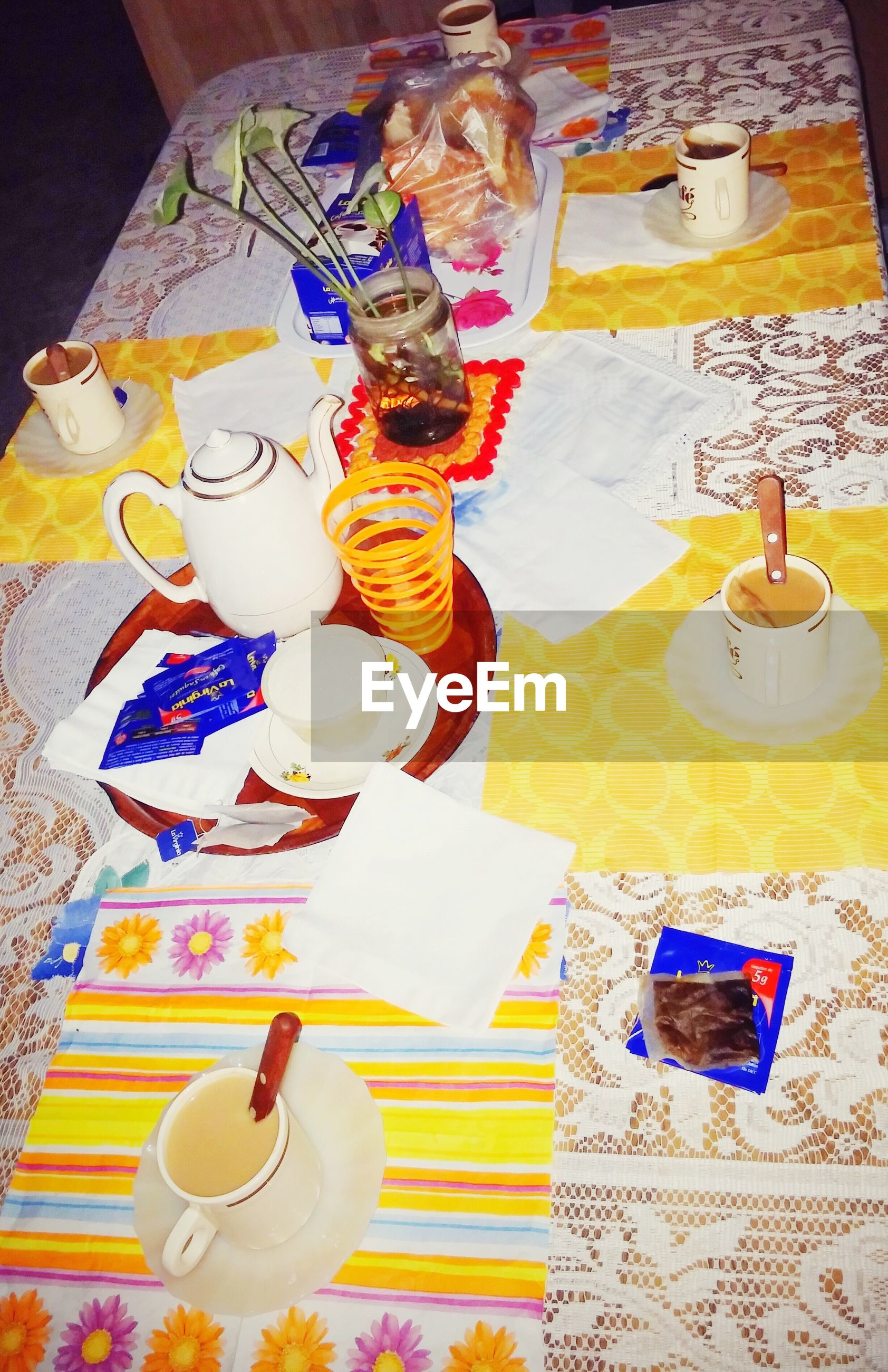 indoors, creativity, art, art and craft, multi colored, table, human representation, still life, high angle view, paper, no people, craft, wall - building feature, home interior, animal representation, variation, text, day
