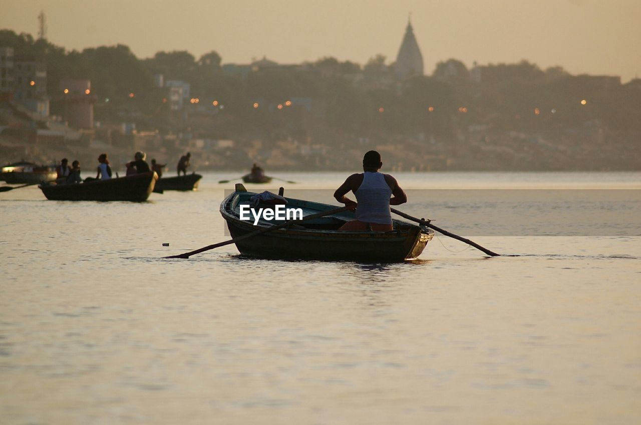 Man In Boat At Sunset