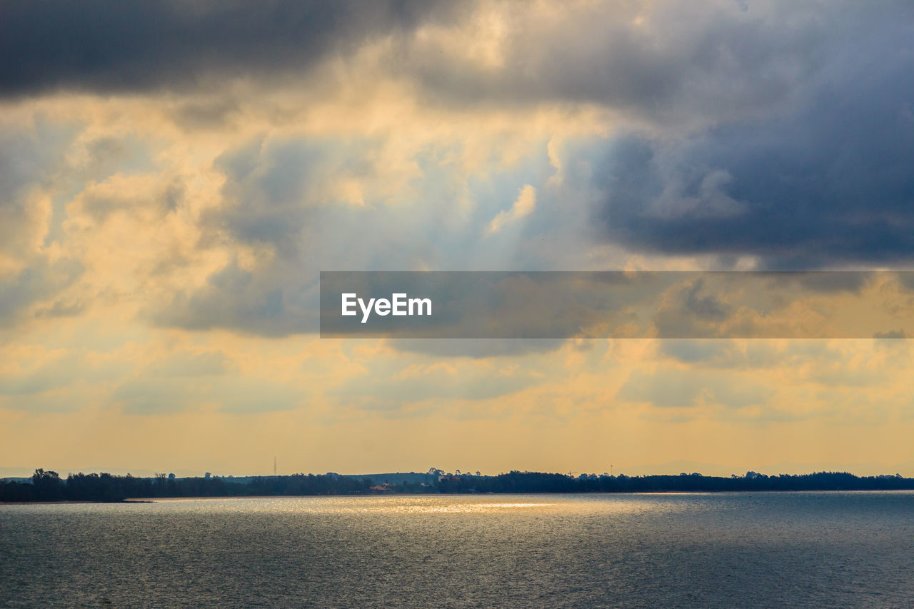 sky, scenics, tranquility, beauty in nature, nature, tranquil scene, cloud - sky, no people, outdoors, water, landscape, sunset, waterfront, scenery, lake, day, tree, view into land
