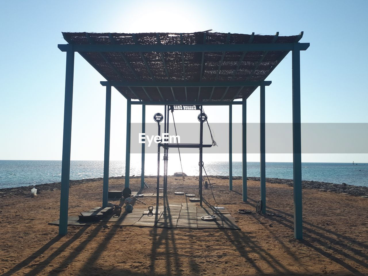 water, sea, sky, beach, horizon, land, horizon over water, nature, scenics - nature, architecture, tranquility, shadow, no people, day, clear sky, tranquil scene, sunlight, sand, built structure, outdoors
