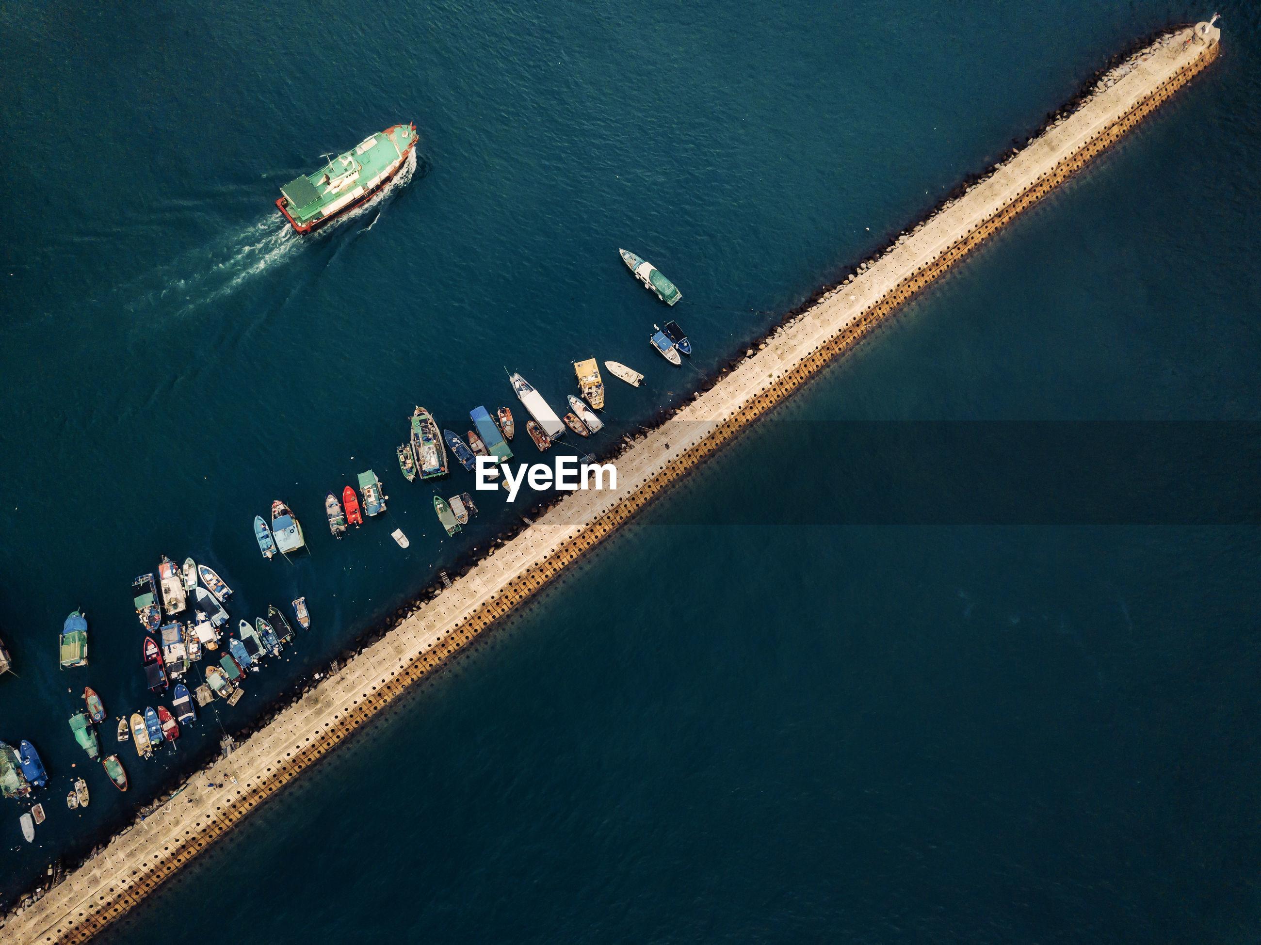 Small fishing boats near the wave barrier in aberdeen bay hong kong
