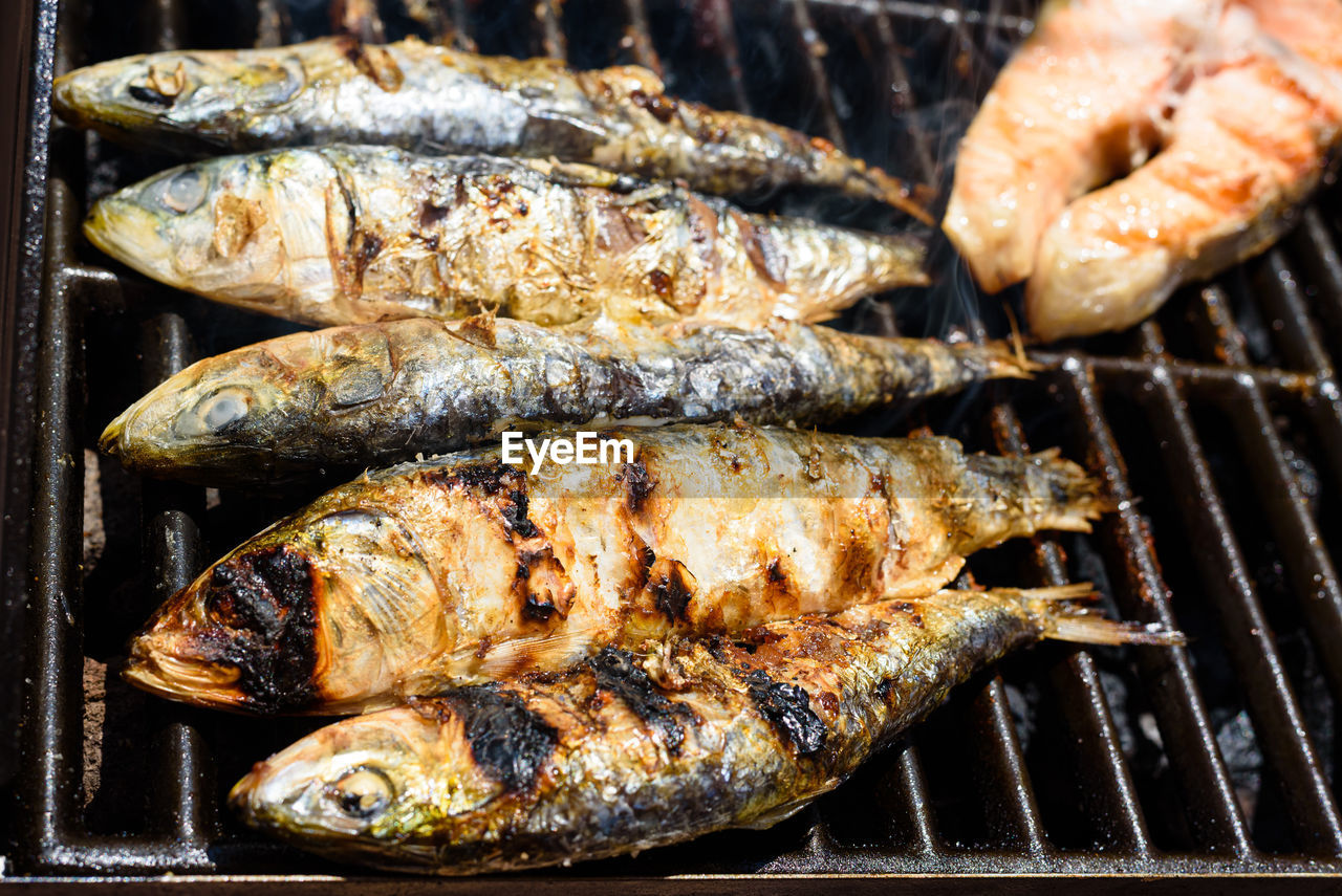 CLOSE-UP OF FISH ON BARBECUE