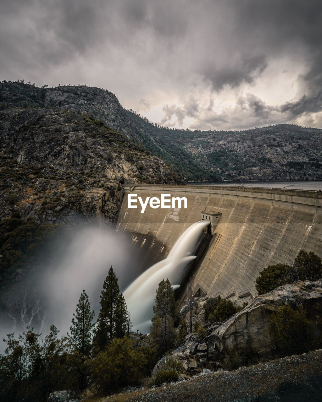 Blurred Motion Of Water From Dam Against Sky