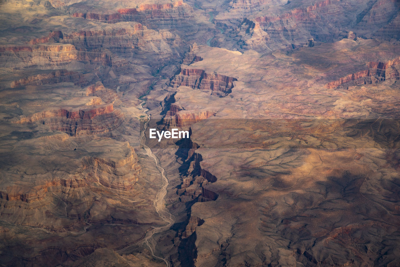 environment, rock, scenics - nature, non-urban scene, rock formation, landscape, nature, rock - object, no people, travel destinations, beauty in nature, aerial view, tranquility, land, high angle view, solid, day, canyon, tranquil scene, geology, outdoors, climate, eroded, arid climate, formation