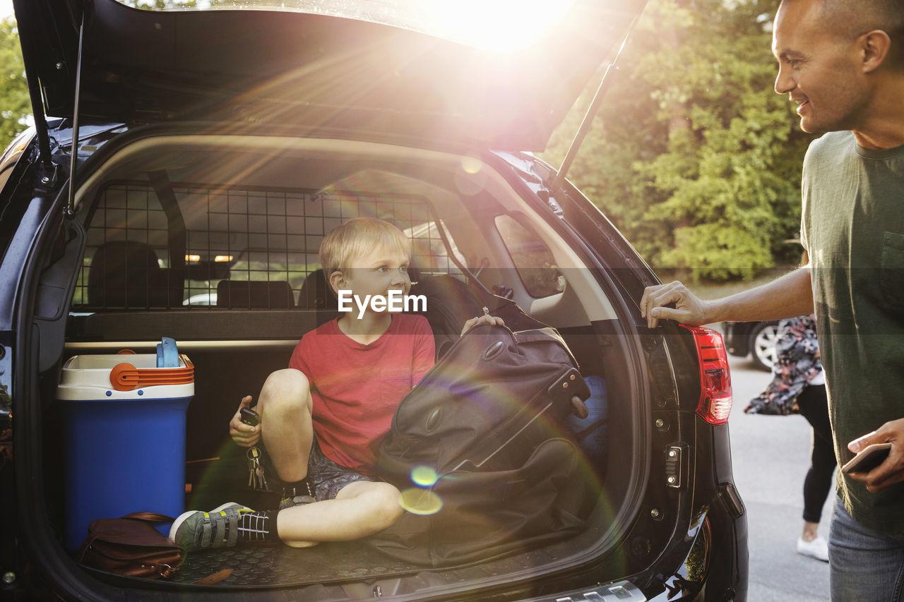 BOYS SITTING IN CAR