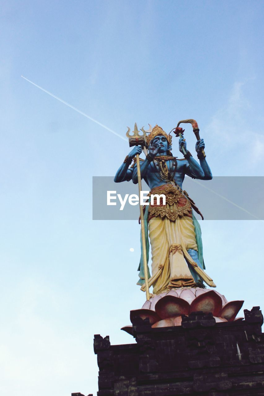 sky, sculpture, human representation, representation, art and craft, statue, low angle view, belief, spirituality, religion, male likeness, creativity, female likeness, nature, day, no people, craft, cloud - sky, architecture, vapor trail, angel