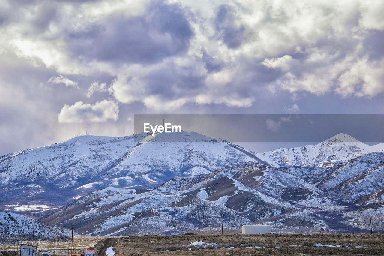 mountain, cloud - sky, snow, cold temperature, winter, sky, beauty in nature, scenics - nature, snowcapped mountain, mountain range, environment, tranquil scene, nature, landscape, tranquility, no people, day, non-urban scene, outdoors, mountain peak