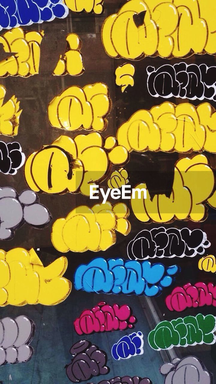 graffiti, multi colored, text, communication, street art, yellow, day, full frame, no people, outdoors