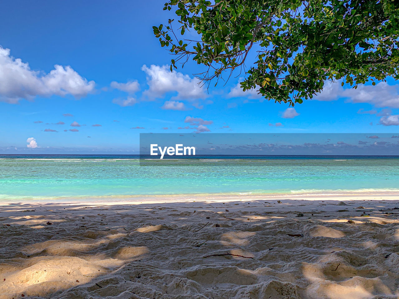 sky, water, sea, beauty in nature, scenics - nature, tranquil scene, land, horizon over water, tranquility, beach, cloud - sky, blue, horizon, nature, no people, idyllic, non-urban scene, day, tropical climate, outdoors, turquoise colored
