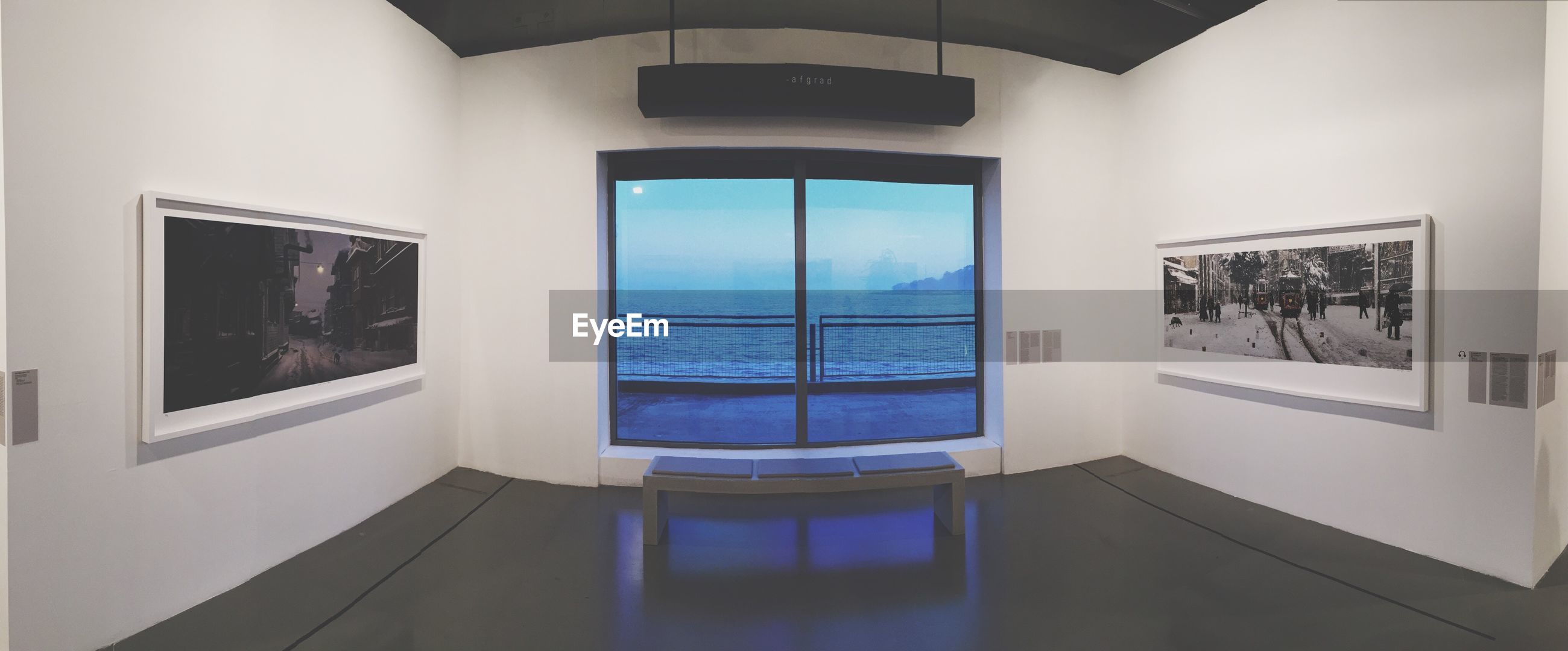 indoors, window, architecture, built structure, glass - material, transparent, sky, house, water, day, reflection, building exterior, no people, blue, building, absence, sunlight, sea, door, empty