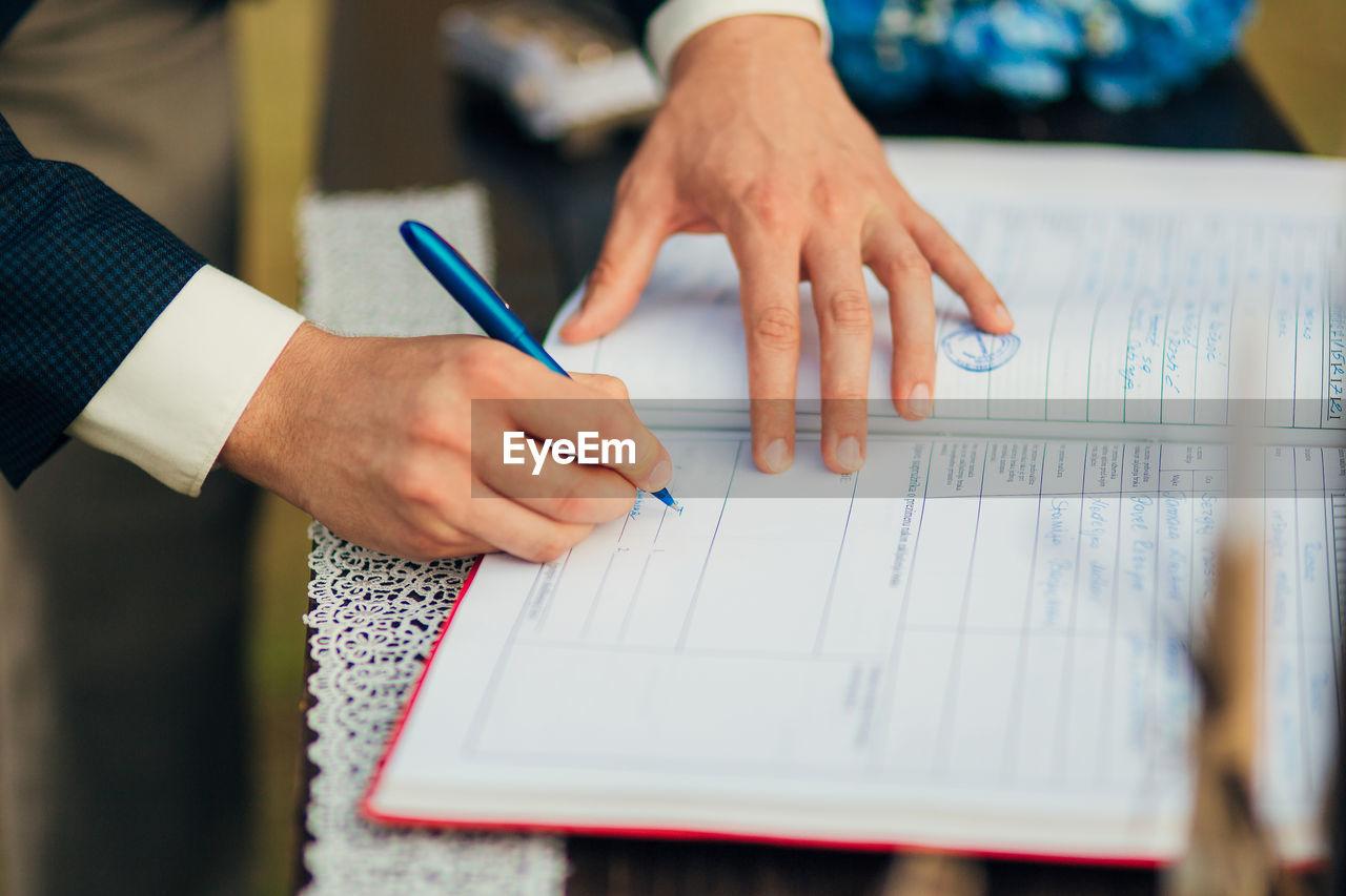 Man signing on register at wedding