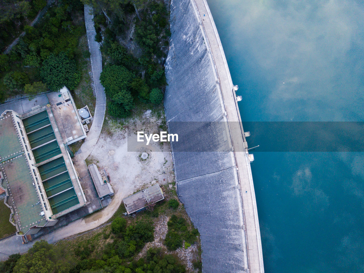 water, nature, built structure, architecture, day, high angle view, no people, outdoors, sea, plant, building exterior, aerial view, transportation, sky, tree, scenics - nature, cloud - sky, tilt, beauty in nature, swimming pool
