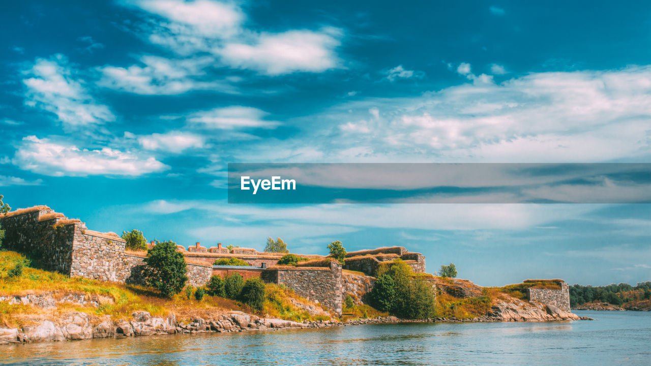 sky, cloud - sky, water, architecture, beauty in nature, day, nature, history, the past, scenics - nature, no people, built structure, sea, tranquil scene, waterfront, tree, tranquility, plant, building exterior, outdoors