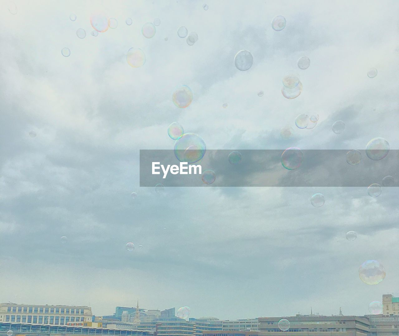 sky, architecture, built structure, building exterior, cloud - sky, nature, no people, city, bubble, building, day, water, rainbow, outdoors, multi colored, mid-air, low angle view, transparent, skyscraper