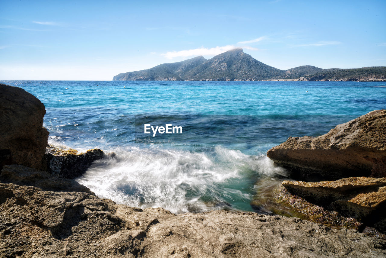 sea, water, beauty in nature, sky, scenics - nature, rock, land, rock - object, beach, solid, mountain, tranquil scene, nature, no people, tranquility, day, rock formation, motion, non-urban scene, horizon over water, outdoors, power in nature, rocky coastline