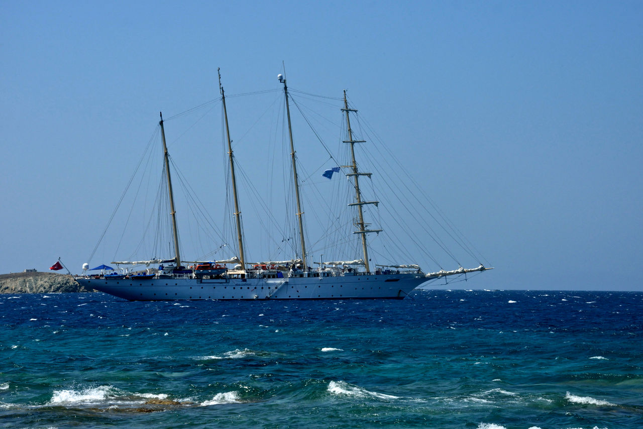sea, sky, water, nautical vessel, sailboat, mode of transportation, transportation, sailing, clear sky, ship, mast, pole, nature, blue, horizon over water, sailing ship, day, beauty in nature, horizon, no people, outdoors, yacht, luxury
