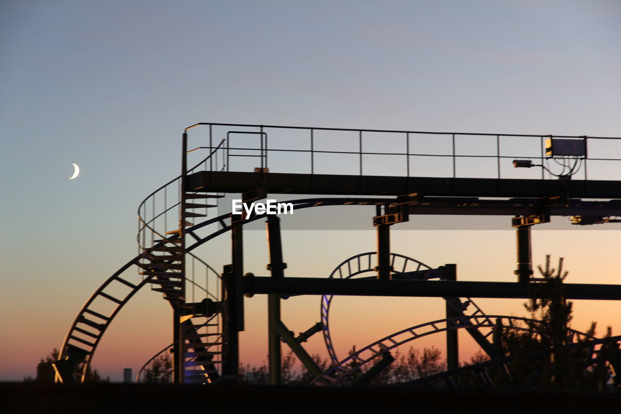 Roller Coaster Ride Tracks Against Clear Sky