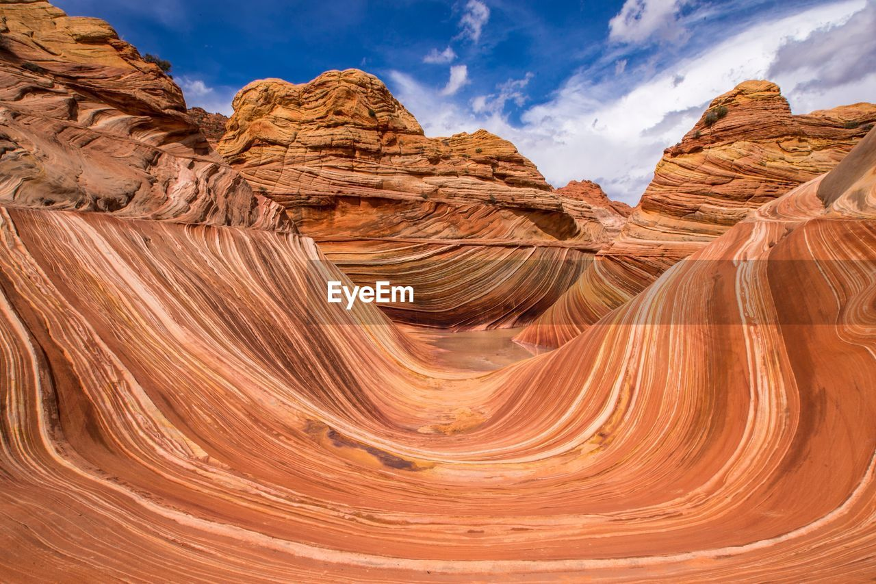 Scenic View Of Rocky Mountains Against Sky On Sunny Day At Coyote Buttes