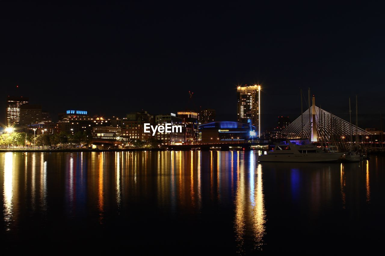 illuminated, night, architecture, water, reflection, built structure, building exterior, waterfront, city, sky, no people, river, copy space, nature, building, clear sky, transportation, glowing, cityscape, nightlife, skyscraper, bay