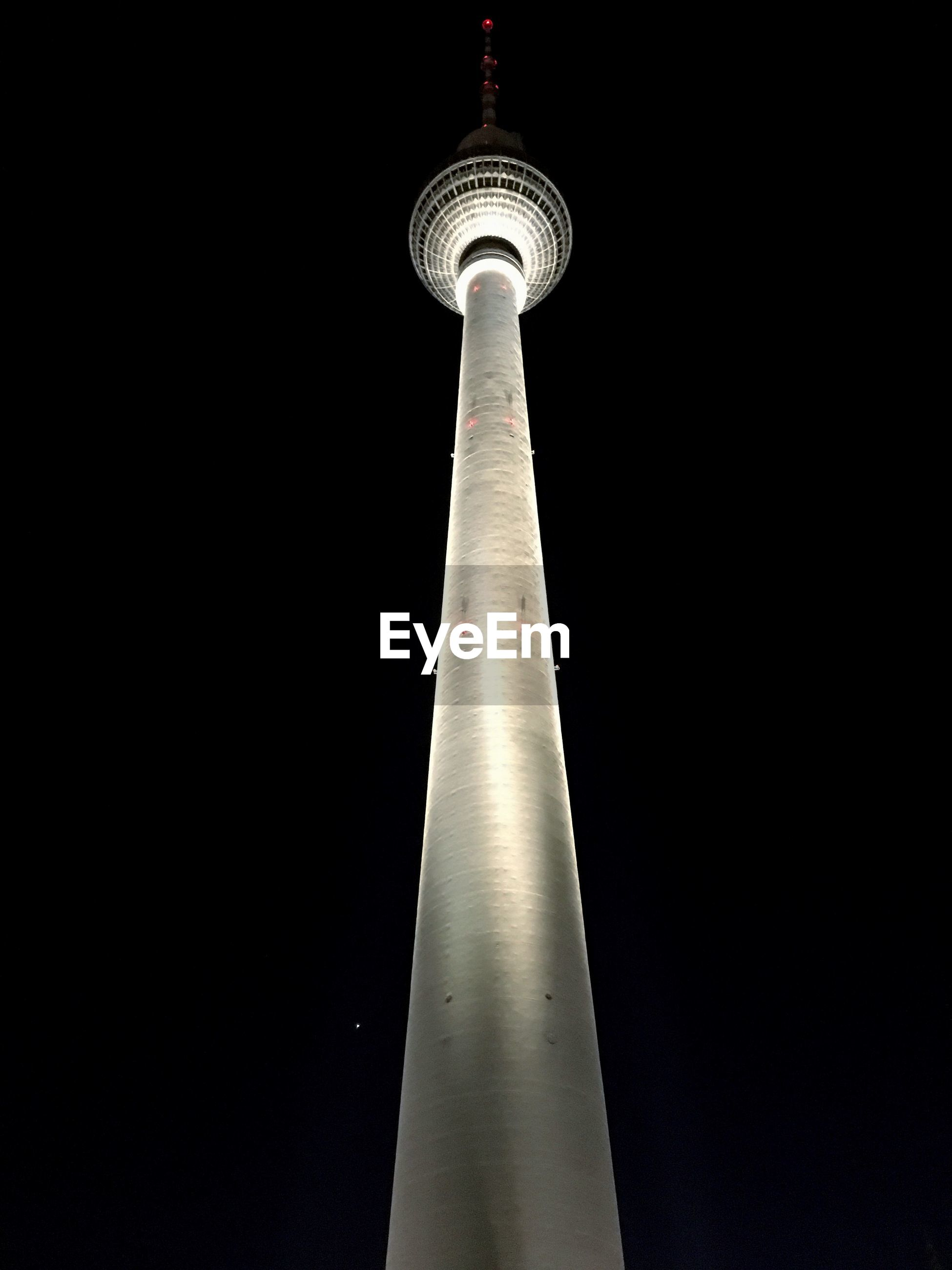 LOW ANGLE VIEW OF COMMUNICATIONS TOWER AT NIGHT