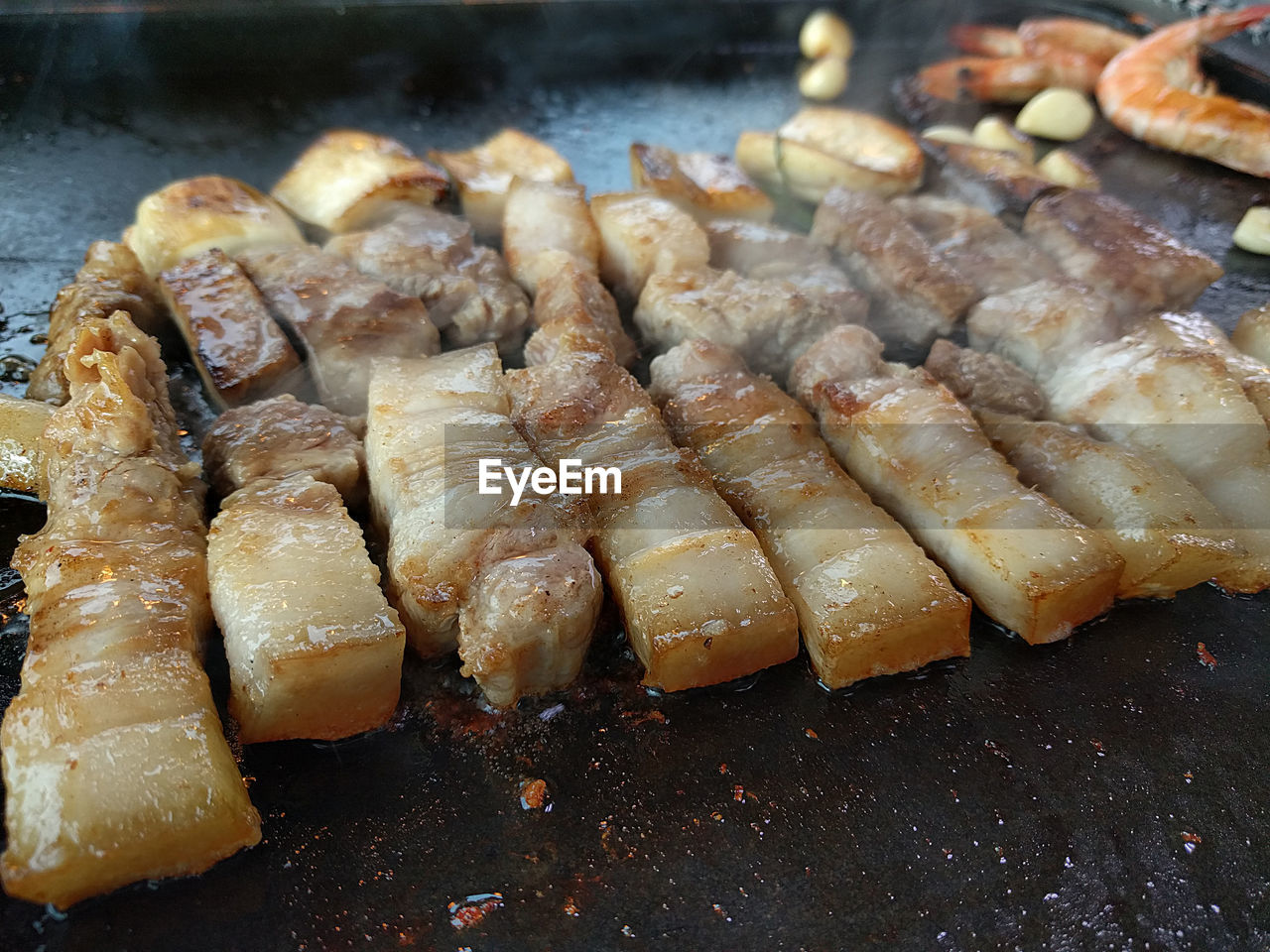 Close-Up Of Meat Being Cooked
