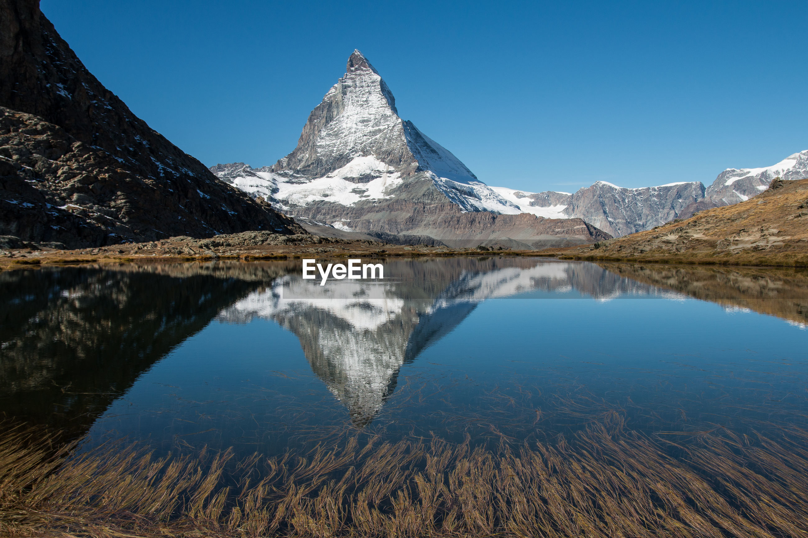 Reflection of mountain peak in calm lake