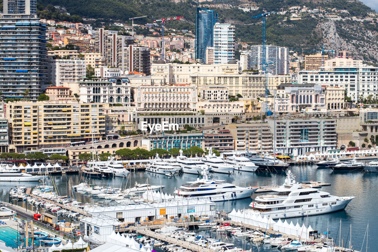 city, architecture, building exterior, skyscraper, cityscape, sea, nautical vessel, travel destinations, built structure, day, downtown district, aerial view, outdoors, harbor, no people, yacht, water, beach, urban skyline