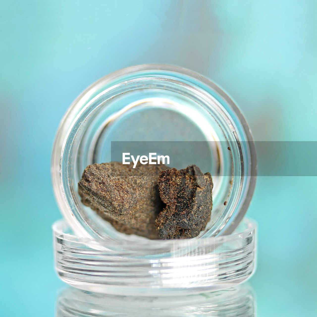 jar, glass - material, container, still life, indoors, close-up, no people, table, studio shot, transparent, selective focus, food and drink, focus on foreground, food, colored background, blue, open, wellbeing, marijuana - herbal cannabis, airtight, blue background