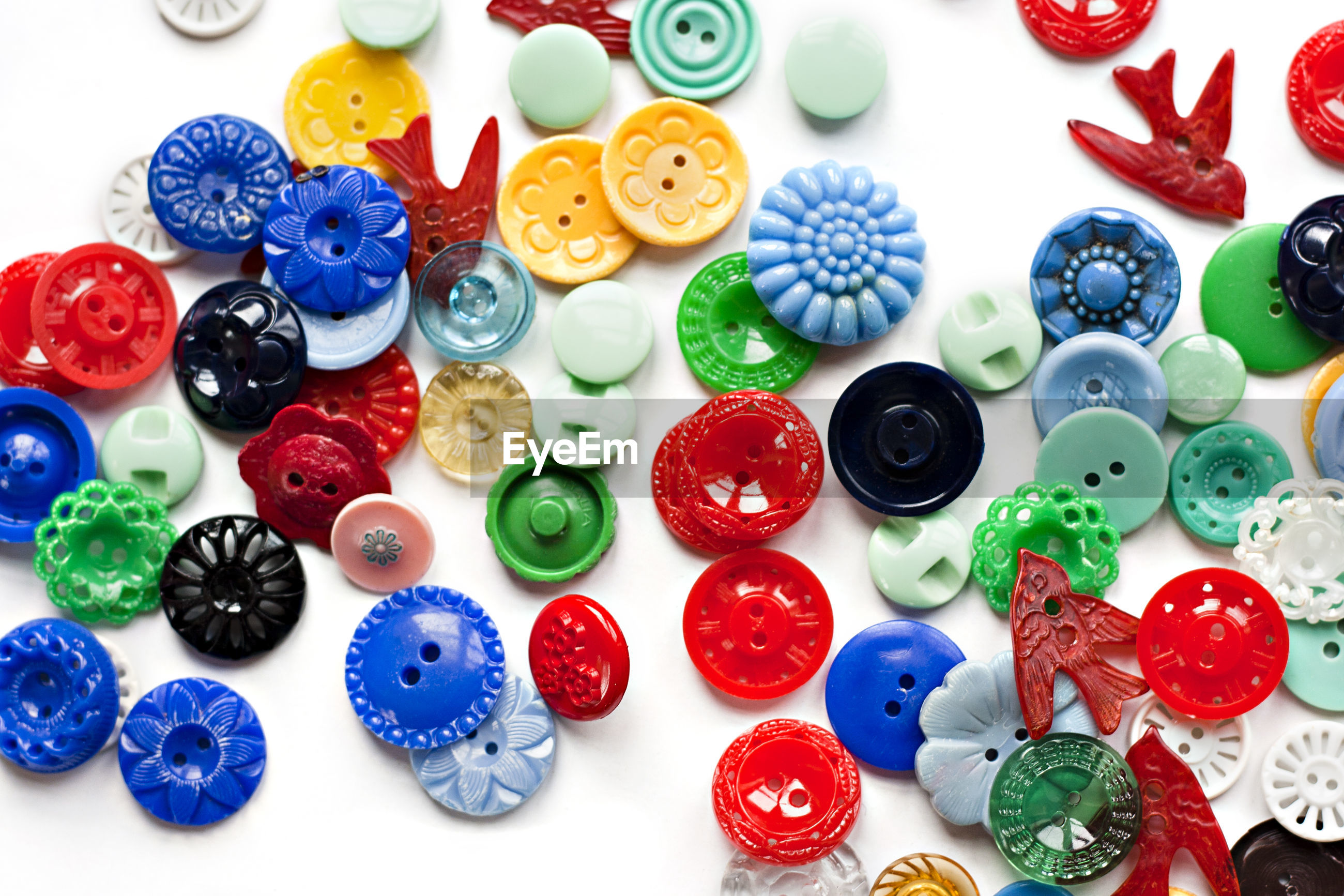 Full frame shot of colorful buttons on white background