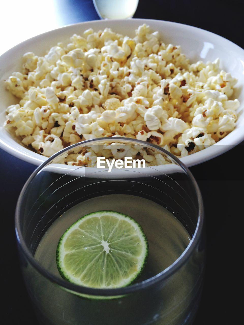Close-Up Of Popcorn And Lemon Juice