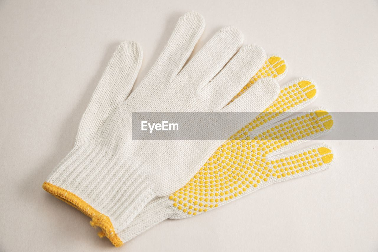 High angle view of gloves on white background