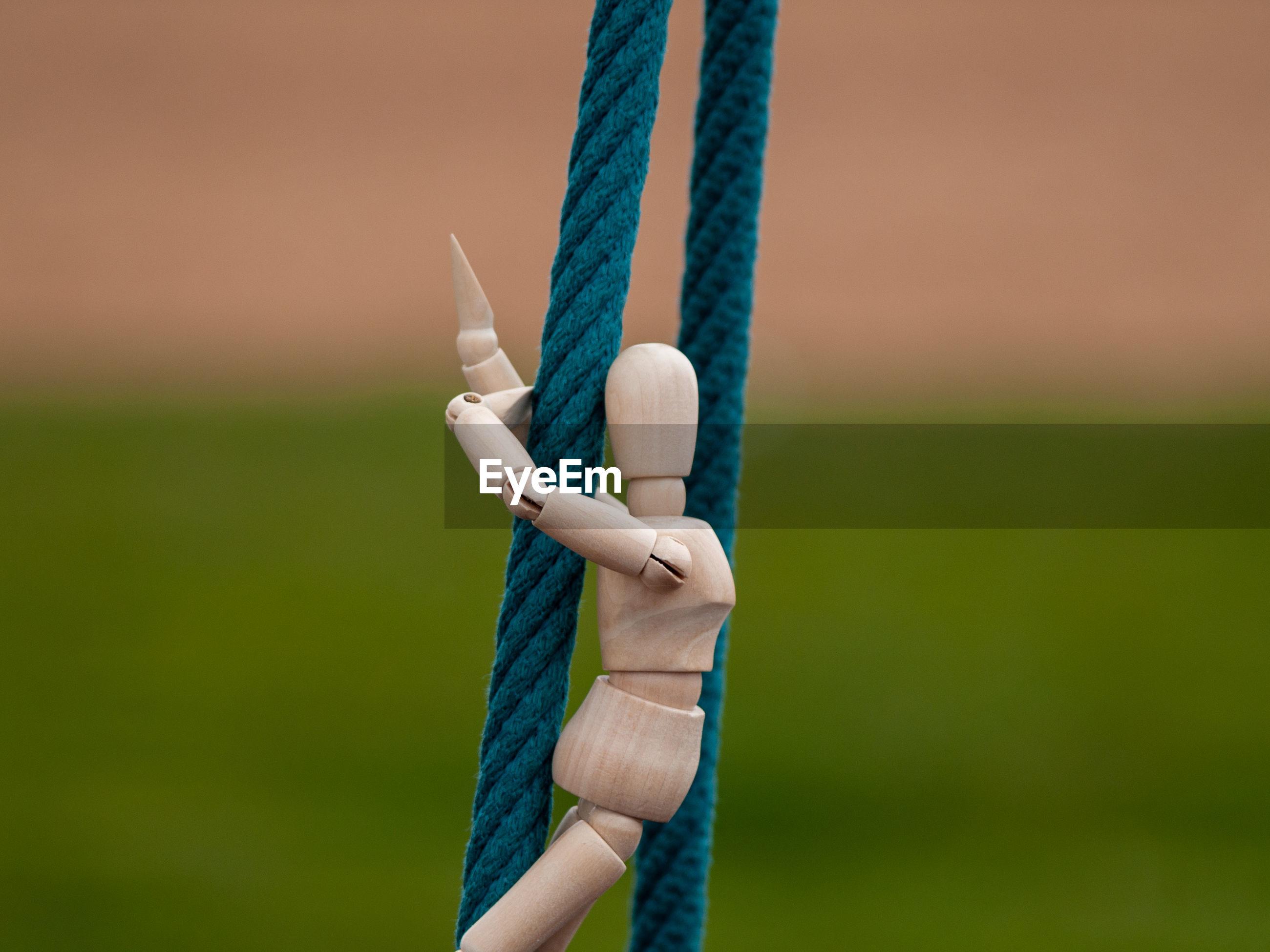 Figurine on rope