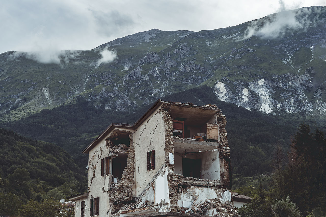 Panoramic view of buildings and mountains against sky