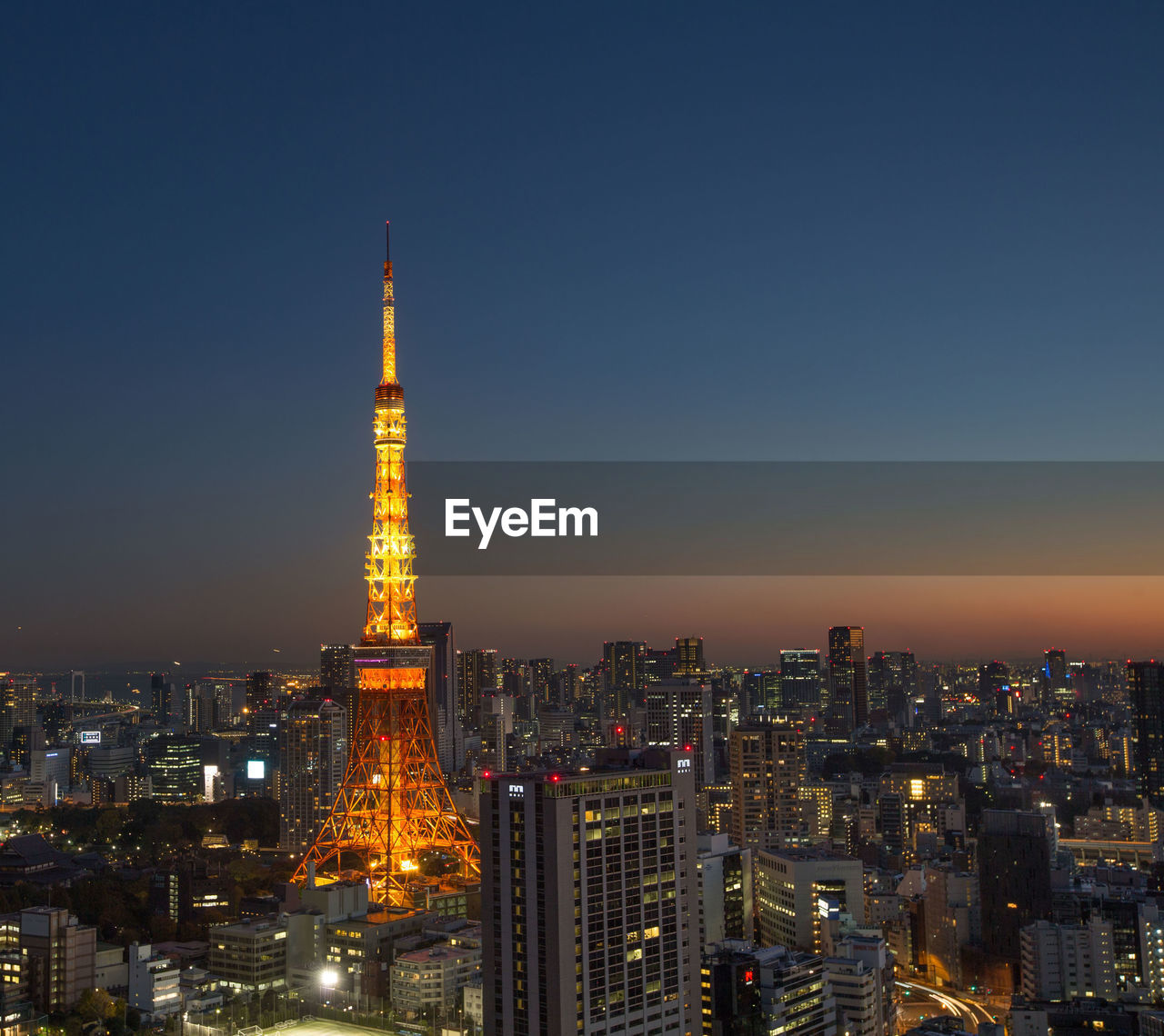 Illuminated Tokyo Tower And City Against Clear Sky At Dusk
