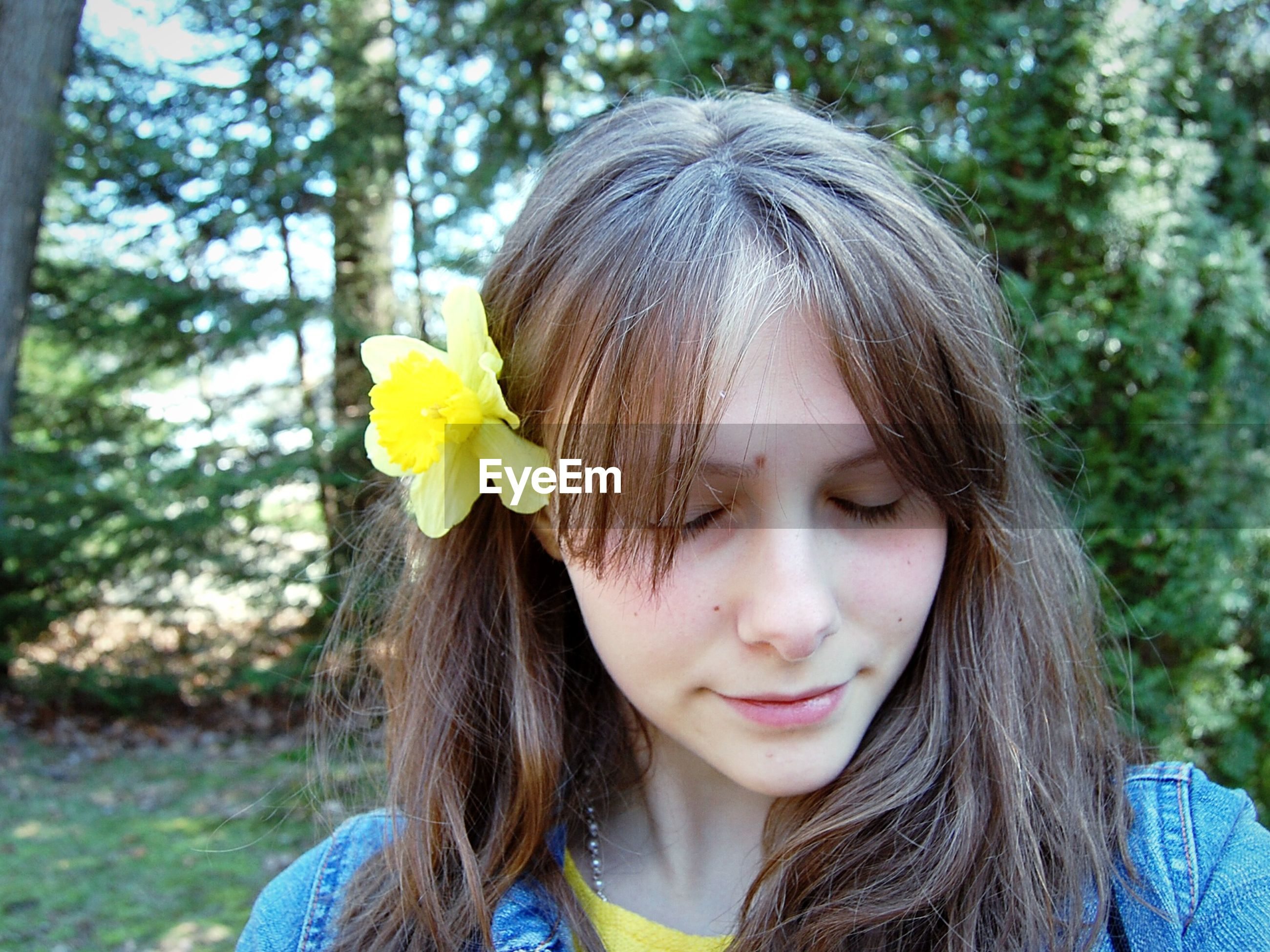 one person, childhood, outdoors, front view, day, girls, flower, yellow, close-up, headshot, tree, real people, nature, people