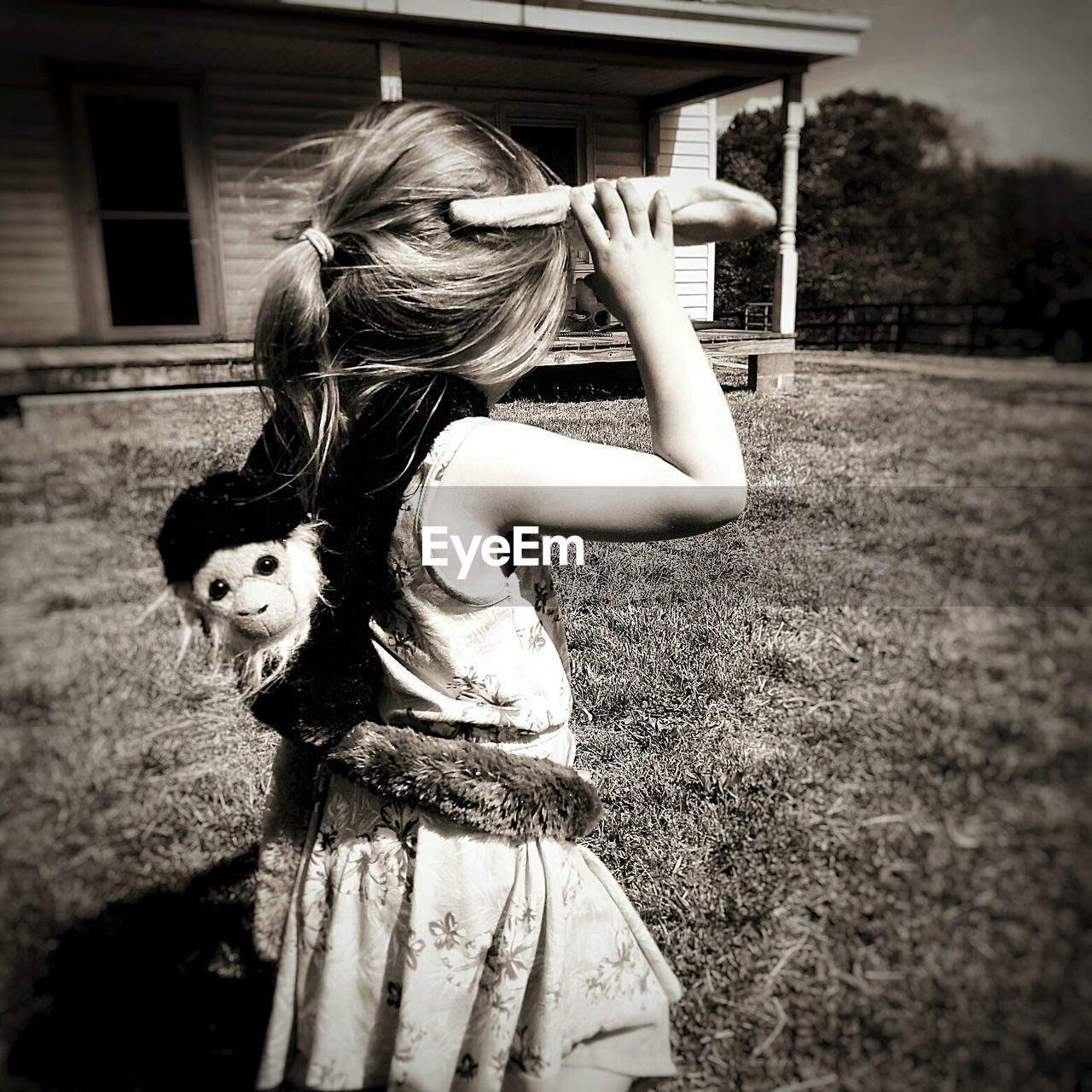 girls, real people, childhood, one person, outdoors, playing, day, lifestyles, tree, animal themes, building exterior, mammal, people