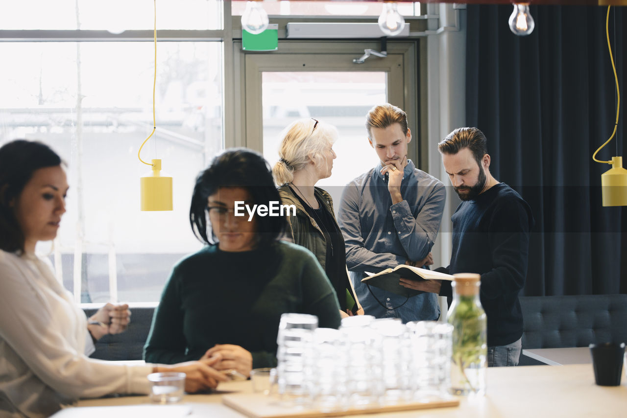 group of people, males, business, office, men, business person, adult, young adult, businessman, businesswoman, table, colleague, women, mid adult men, indoors, planning, cooperation, mid adult, coworker, teamwork, strategy, brainstorming