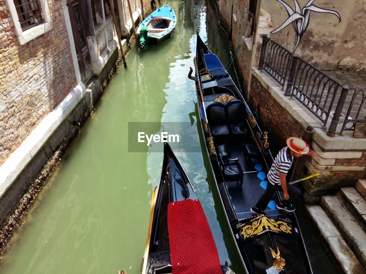 High Angle View Of Man On Gondola At Canal