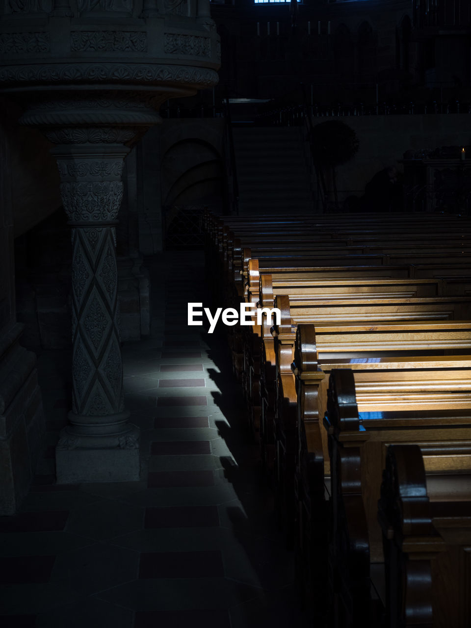 Empty Aisle With Cropped Pews In Row