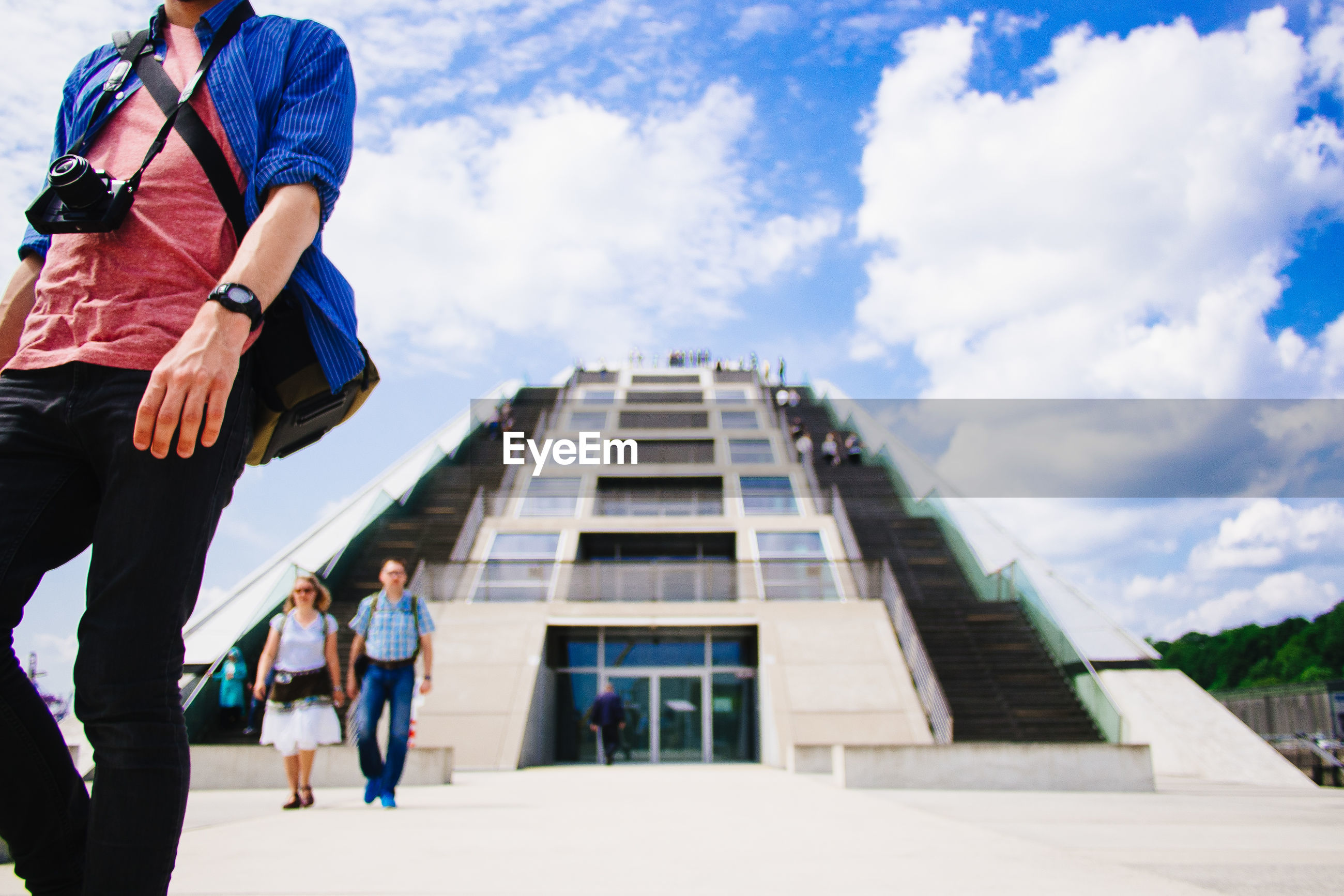 Low section of man against modern building