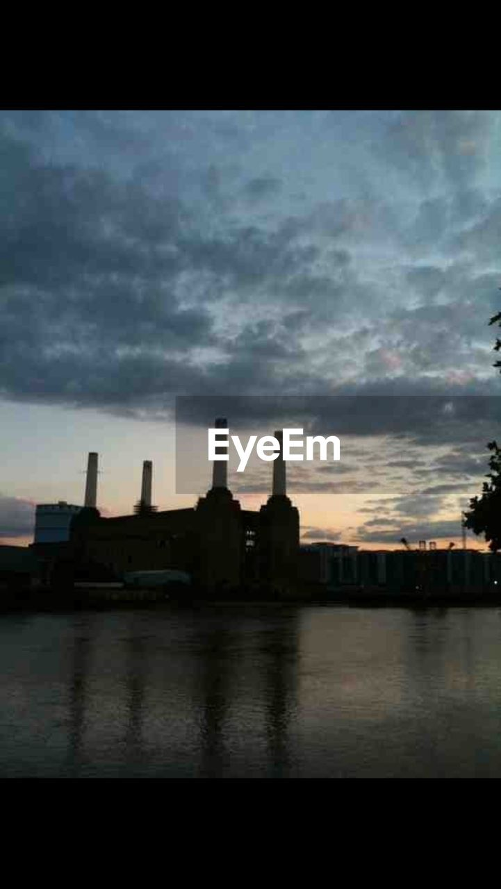 architecture, sky, built structure, building exterior, cloud - sky, no people, water, reflection, waterfront, sunset, industry, outdoors, city, skyscraper, day
