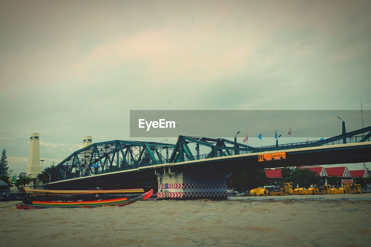 bridge - man made structure, transportation, connection, built structure, architecture, mode of transport, sky, river, no people, water, outdoors, day, nautical vessel, nature