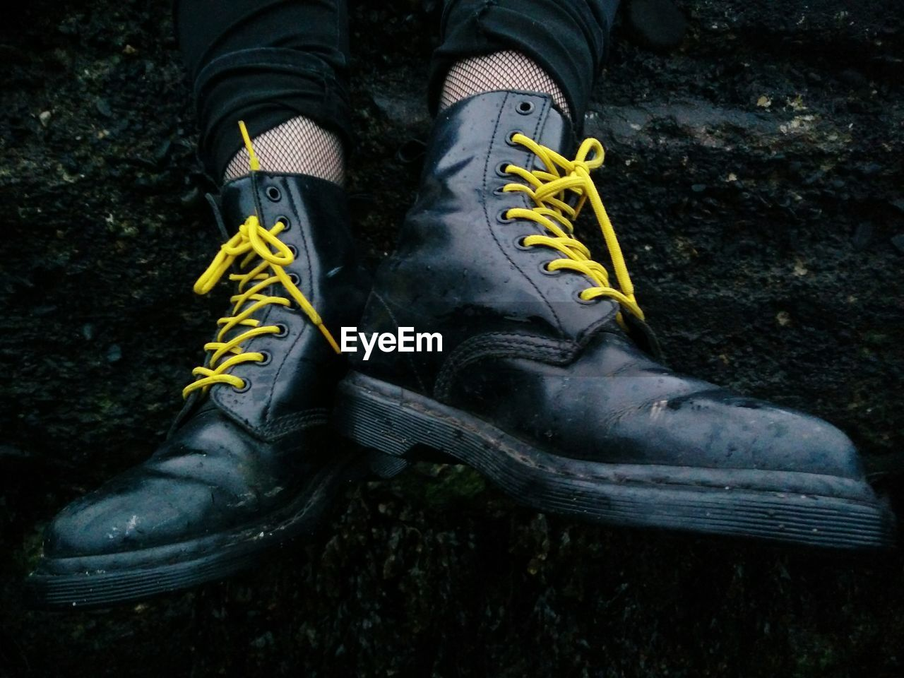 Low Section Of Man Wearing Boots