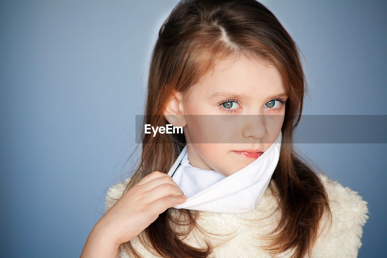 PORTRAIT OF CUTE GIRL OVER WHITE BACKGROUND