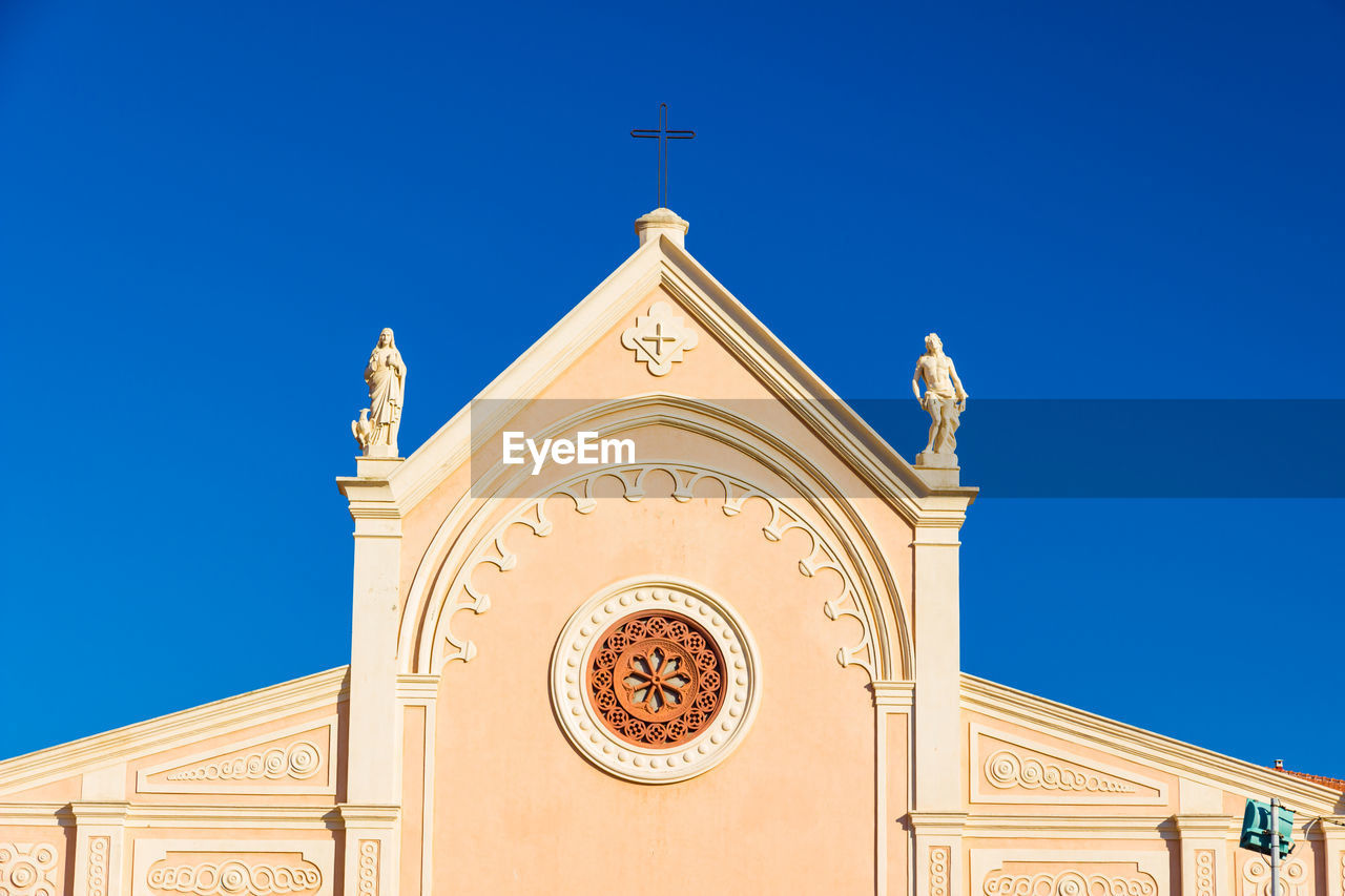 belief, religion, architecture, built structure, spirituality, sky, place of worship, building exterior, blue, building, low angle view, clear sky, no people, nature, cross, sunlight, day, arch, outdoors, ornate