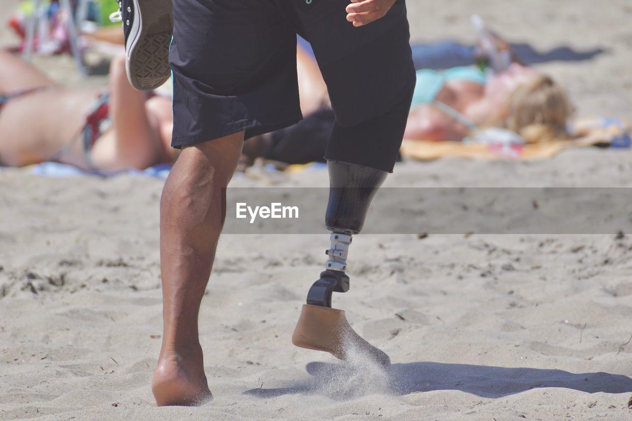 Man with disability on beach